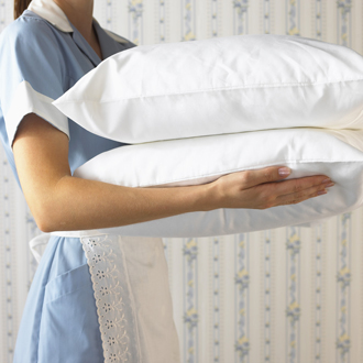 Side View of Maid Carrying Pillows