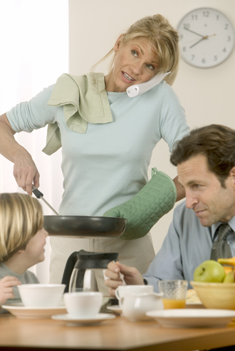 Busy Mother Cooking For Family